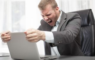 Businessman frustrated by slow internet connection