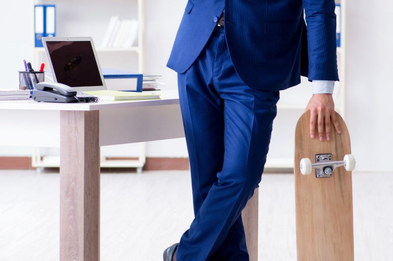 Business man and skateboard with modern office design