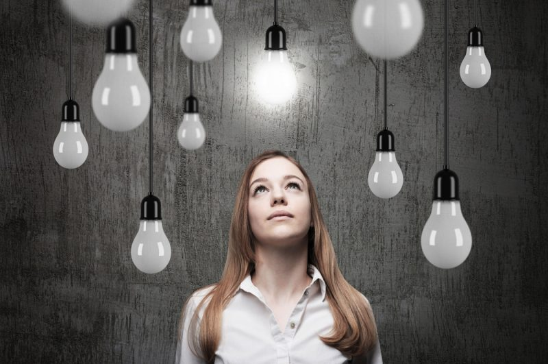 Businessperson and light bulbs
