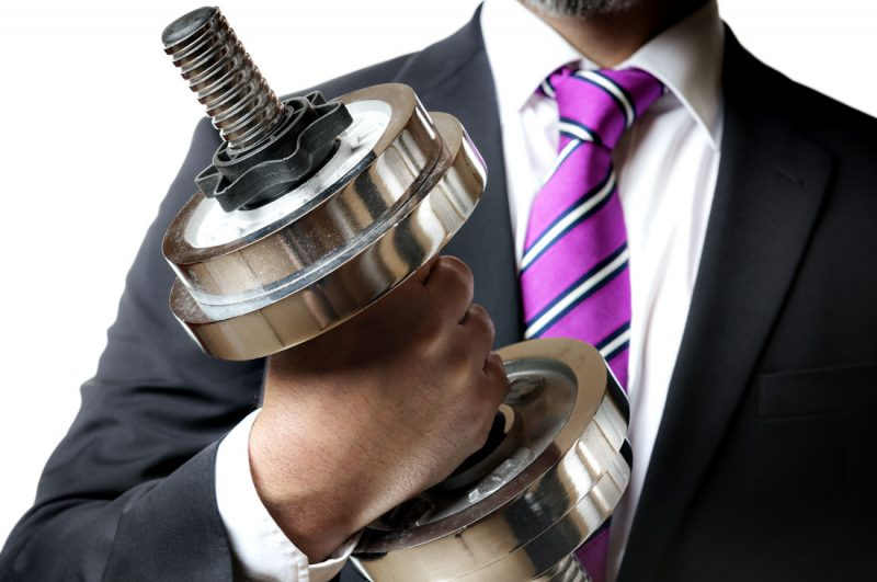 Businessperson and dumbbell