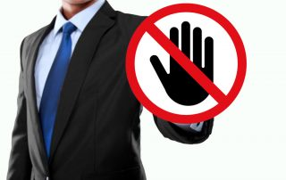 Businessman with 'do not touch' sign